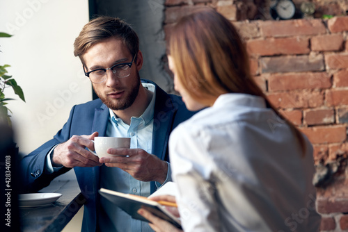 Fotografie, Obraz young couple work colleagues professional communication in a cafe