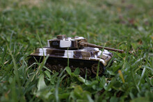 Plastic Toy Panzer Stands In The Grass