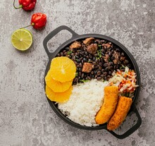 Feijoada, Roasted Banana And Orange Slice, Culinary Tradition, Brazilian Stone Background, Top View