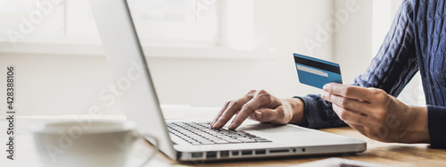 Fotografie, Obraz Woman using laptop computer with credit card making online order, banner