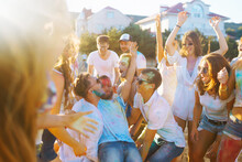 Group Of People Have Fun At The Holi Festival Of Colors. Smiling Faces In Colorful Powder. Celebrating Traditional Indian Spring Holiday. Party, Vacation Concept. Friendship And Celebration Concept.