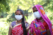 Indian Women Wearing Colorful Saris And Protective Masks To Protect Themselves From Coronavirus