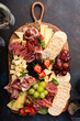 canvas print picture Cheese or charcuterie board on dark background