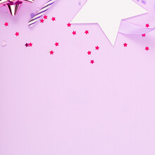 Party Holiday Background With Ribbon, Stars, Birthday Candles And Confetti On Pink Background. Studio Photo