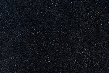 Background And Textured Of Image Of An Asphalt Surface That Overlooks A Mixture Of Rock And Black Rubber.