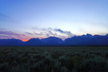 Colorful Sunset Sky Over The Mountain Peaks In Grand Teton National Park In Wyoming, United States