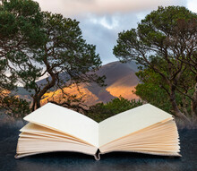 Majestic Autumn Fall Landscape Image Of View From Castlehead In Lake District Towards Skiddaw At Sunset With Beautiful Lighting In Sky Coming Out Of Pages In Imaginary Book