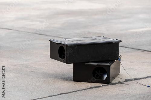 Photo Poison rat trap box on the floor