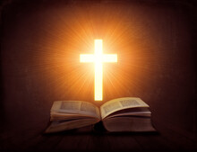 Open Book With Glowing Cross Above It; Religion Concept