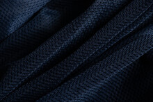 Dark Blue Fabric Wrinkled As Background Close Up