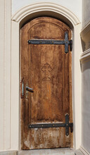 An Old Wooden Door With A Cross Engraved On It