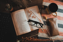 Old Book And Glasses On The Table