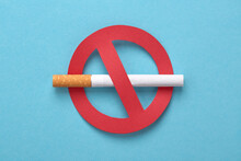 No Smoking Icon. Red Forbidden Sign With A Cigarette On Blue. No Tobacco Day, No Smoking Concept.
