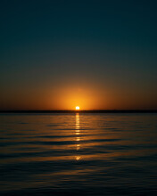 Beautiful View Of The Calm Ocean With Tiny Waves During The Sunset On A Summer Day