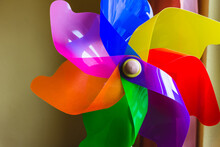 Colorful Plastic Whirligig On A Wall Background