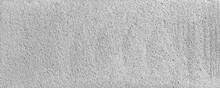 Texture Or Cut Of A Building Foam Block, Close-up Fragment, Texture Or Wallpaper