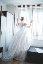 Back View Of A Gorgeous Bride Waiting For The Groom In Her Room Looking Outside The Window