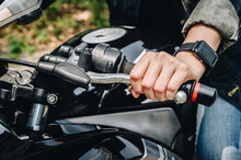 Close Up Of Motorcycle Rider Hand Holding Clutch. A Motorcycle Clutch Is A Mechanical Device That Engages Or Disengages The Drive From The Engine To The Transmission.