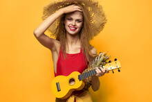 Woman Holding Ukulele Straw Hat Lifestyle Exotic Yellow Background