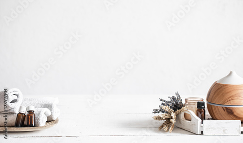 Fototapeta Spa composition with aroma diffuser and natural oils copy space. obraz