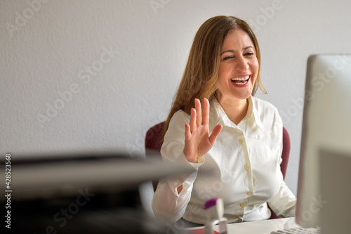 Businesswoman interacting on a video conferencing call or remote working meeting - fototapety na wymiar