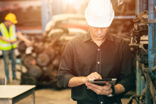 Professional Adult Engineer Male Attending Duty Work In Factory Working Checking Stock Inventory Data With Tablet Computer