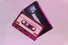 Audio Cassette And Video Tape On Background. VHS Video Tape Background. Audio Cassette Background.