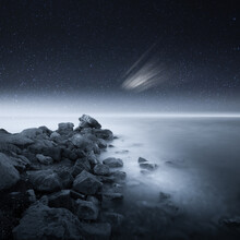 Rocky Shore Surrounded By The Sea With Long Exposure Under A Breathtaking Starry Sky