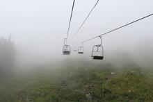 Empty Ski Lift Seats In Sheregesh In Heavy Fog In Summer
