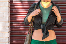 Stylish Woman With A Facemask Wearing A Crop Top With A Denim Jacket Outdoo