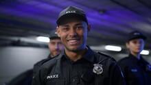 Policeman Smiling At Camera. Positive Cop In Uniform Posing At Camera
