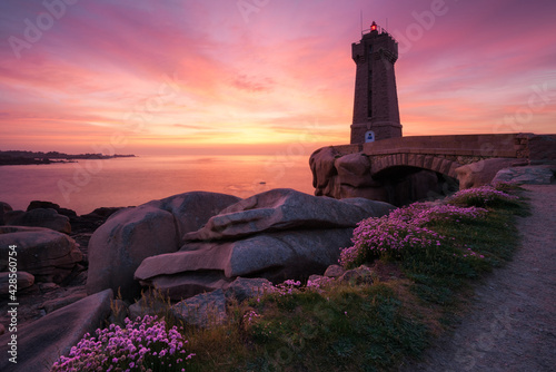 Tela The Ploumanac'h lighthouse at sunset, Brittany, France