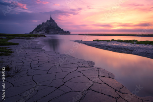The Mont Saint Michel at the sunrise. Normandy, France - fototapety na wymiar
