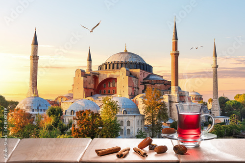 The Hagia Sophia Mosque and traditional turkish tea party nearby, Istanbul - fototapety na wymiar