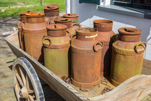 Old Rusty Milk Cans On A Wooden Cart In Historic Village Orvelte, Netherlands