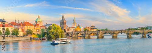 Fotografering Famous iconic image of Charles bridge and Praguecity skyline