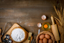 Bread Flour With Fresh Egg And Accessories Bakery On Wood Background,