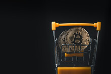 Bit Coin In Yellow Trolley On Black Background, Electronic Virtual Money For Web Banking