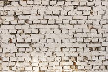 An Old White Painted Brick Wall With Uneven Bricks And Red Spots Background