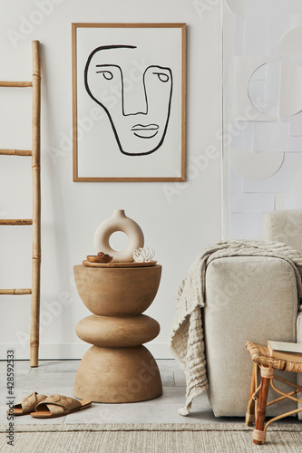 Stylish interior of living room at cozy home with mock up poster frame, wooden stool, decoration and elegant personal accessories in modern home decor. Template. - fototapety na wymiar