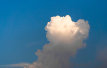 Puffy Smoke-like Cloud In The Clear Blue Sky