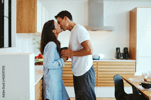 Couple kissing in the morning