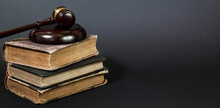 Law Book With A Wooden Judges Gavel On Table