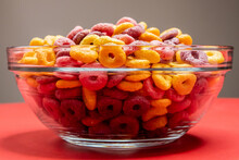 Closeup Of A Bowl Of Cereal On A Red Surface Against A Gray Background