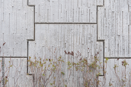 Fotografie, Obraz grey prefab retaining wall panels and shrubbery - cloudy weather