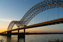 Bridge Over A River In The Mud Island Park Under The Sunlight During The Sunrise In The USA