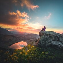 Silhouette Of A Person On A Mountain Top