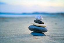 Closeup Shot Of Stone Stacking On A Sand