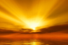 Warm Sunset Over The Ocean With God Rays