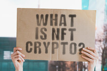 """The Question """" What Is NFT Crypto? """" On A Banner In Men's Hand With Blurred Background. Technology. International. Tokens. Token. Art. Illustration. Video"""